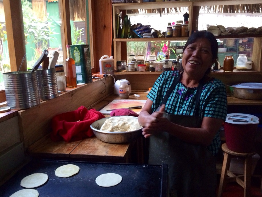 Natalia, the house mama, making tortillas. Natalia is a loveable Mayan woman from the nearest town. She doesn't speak any English, but we get along great with facial expressions and laughter.